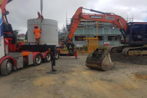 11.5t concrete manhole riser lifted into undermined hole at Mt Roskill