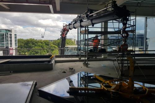 Extracting glass facade from 4th storey window and fixing to exterior Auckland CBD
