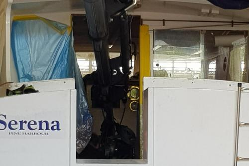 Lifting engine into cabin of boat with flyjib