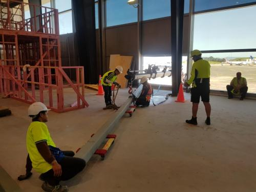 Posting steelwork through terminal window from tarmac at Auckland International Airport